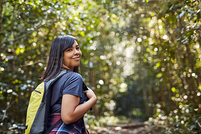 Buy stock photo Cropped shot of a beautiful young woman out hiking on a sunny day