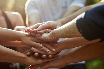 Buy stock photo Shot of a group of friends with their hands together in a huddle