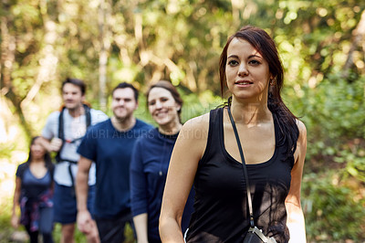 Buy stock photo Shot of a woman out hiking with friends on a sunny day