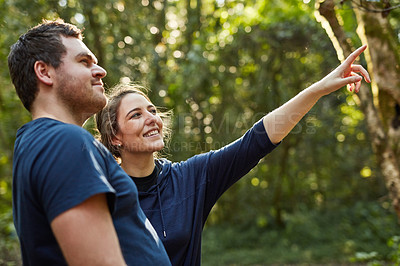 Buy stock photo Shot of a young couple out exploring nature on a sunny day
