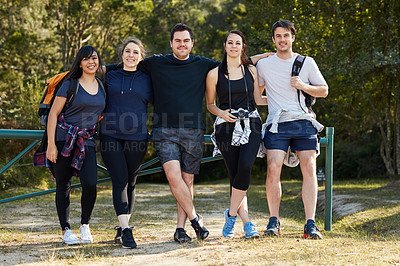 Buy stock photo Shot of a group of young friends out hiking on a sunny day