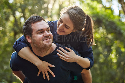 Buy stock photo Shot of an affectionate couple spending the day outdoors