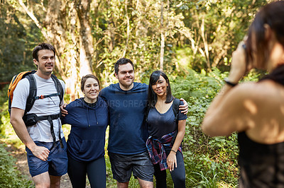 Buy stock photo Shot of a group of friends having their picture taking while out hiking