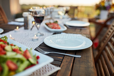Buy stock photo Still life shot of a table setting outdoors