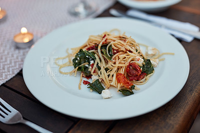 Buy stock photo Still life shot of a plate of pasta on a table outdoors