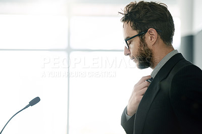 Buy stock photo Shot of a young businessman looking nervous while rehearsing a speech at a conference