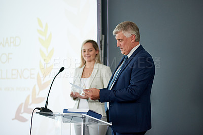 Buy stock photo Shot of a mature businessman delivering a speech during an awards giving ceremony at a conference
