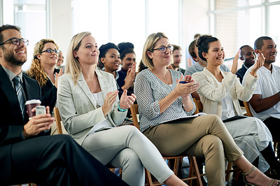 Buy stock photo Shot of an audience of happy people clapping at a business conference
