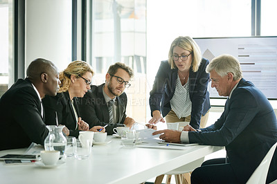 Buy stock photo Shot of corporate businesspeople in the workplace