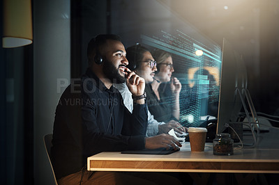 Buy stock photo Cropped shot of a male IT support staff member working the late shift with his team in their office