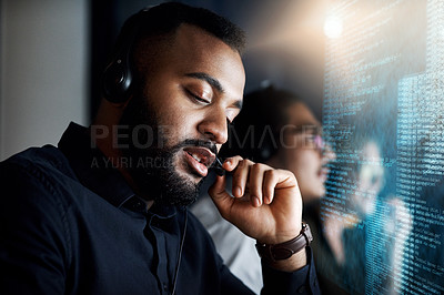Buy stock photo Cropped shot of IT support personnel working the late shift