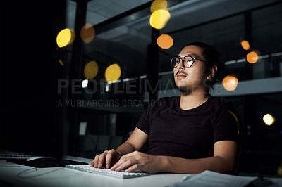 Buy stock photo Cropped shot of a male computer programmer working late in the office on a new code