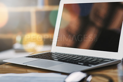 Buy stock photo Still life shot of a laptop with a blank screen in an office