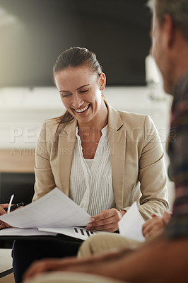 Buy stock photo Shot of a young consultant meeting with clients at their home