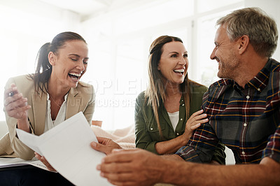 Buy stock photo Shot of a mature couple getting advice from their financial consultant at home