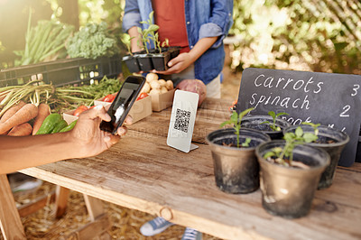 Buy stock photo Cropped shot of an unrecognizable young man scanning a barcode using his cellphone at a stall at the farmers' market
