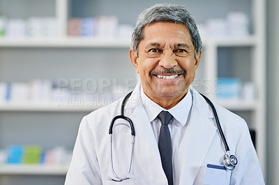 Buy stock photo Portrait of a mature pharmacist standing in a chemist