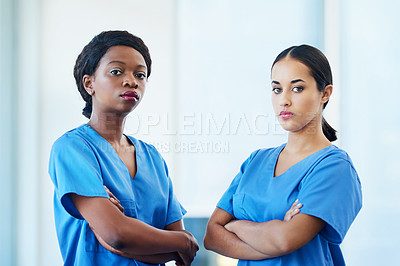 Buy stock photo Portrait of two female nurses standing in a hospital