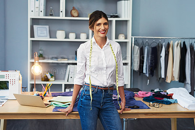 Buy stock photo Cropped portrait of an attractive young fashion designer standing in her workshop