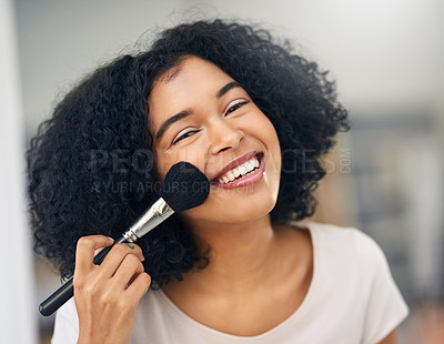 Buy stock photo Portrait of a beautiful young woman applying makeup with a brush at home
