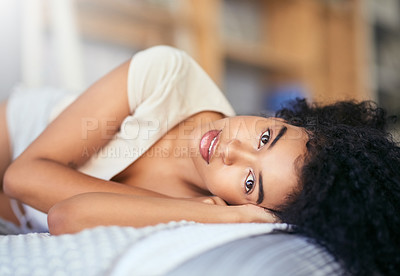 Buy stock photo Portrait of an attractive young woman relaxing on her bed at home