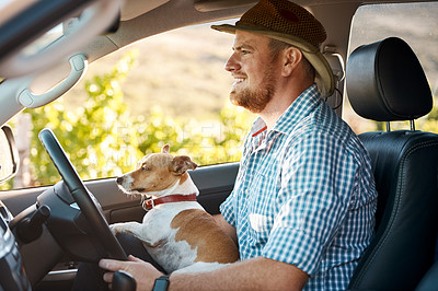 Buy stock photo Shot of a man and his dog driving in the countryside