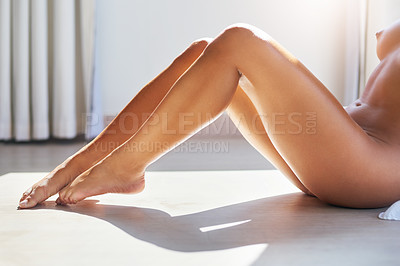 Buy stock photo Cropped shot of a young woman sitting naked on the floor