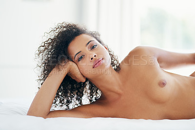 Buy stock photo Shot of a beautiful young woman posing topless at home