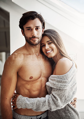 Buy stock photo Portrait of an affectionate young couple in their bedroom at home
