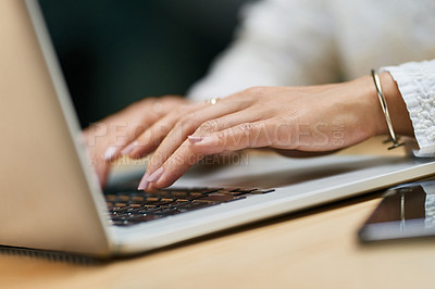 Buy stock photo Closeup shot of an unrecognizable woman using a laptop