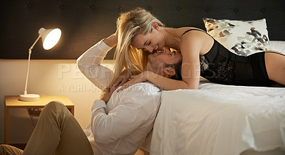 Buy stock photo Shot of a sexy young woman seducing her husband at home