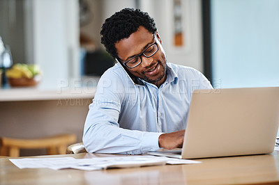 Buy stock photo Cropped shot of handsome young man working from home