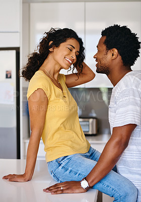 Buy stock photo Cropped shot of a young married couple in the kitchen at home