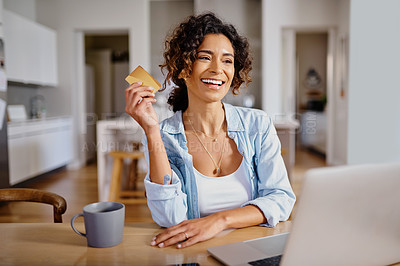 Buy stock photo Cropped shot of a beautiful young woman shopping online using a laptop while chilling at home