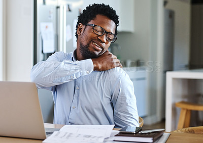 Buy stock photo Cropped shot of a handsome young man working from home