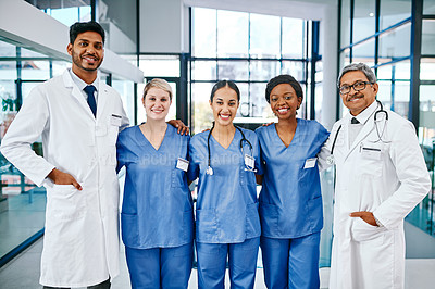 Buy stock photo Portrait of a group of medical practitioners standing in a hospital