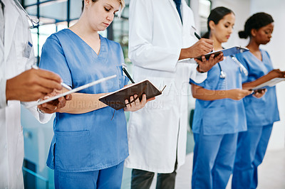 Buy stock photo Closeup shot of a group of medical practitioners working in a hospital
