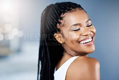 Buy stock photo Cropped shot of a beautiful young woman posing indoors