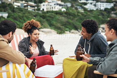 Buy stock photo Shot of young people spending the day at the beach