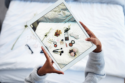 Buy stock photo High angle shot of an unrecognizable woman taking a photo of objects on her bed in her bedroom at home