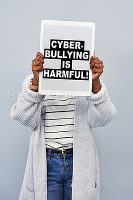 Buy stock photo Studio shot of an unrecognizable young woman holding a tablet with the message