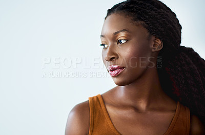 Buy stock photo Studio shot of a beautiful young woman posing against a coloured background