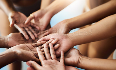 Buy stock photo Cropped shot of a group of women holding their hands together