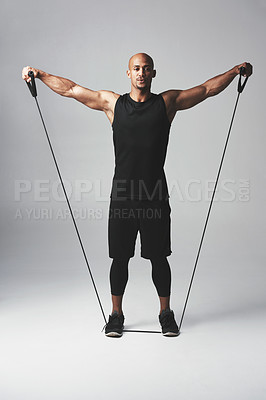 Buy stock photo Studio shot of an athletic young man against a grey background