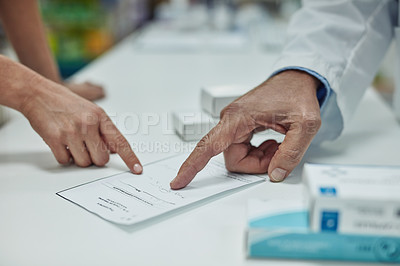 Buy stock photo Cropped shot of a customer getting her prescription filled at a chemist