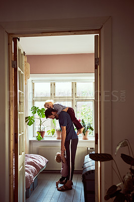 Buy stock photo Full length shot of a young man trying to get his children ready in the morning