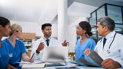 Buy stock photo Shot of a team of doctors having a meeting in a hospital