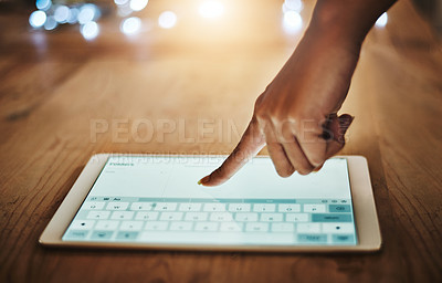 Buy stock photo Cropped shot of a businesswoman using a digital tablet during a late night at work