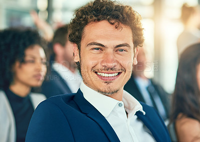 Buy stock photo Cropped portrait of a handsome young businessman sitting in a conference room during a seminar