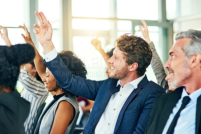 Buy stock photo Cropped shot of a group of businesspeople sitting with their hands raised in a conference room during a seminar